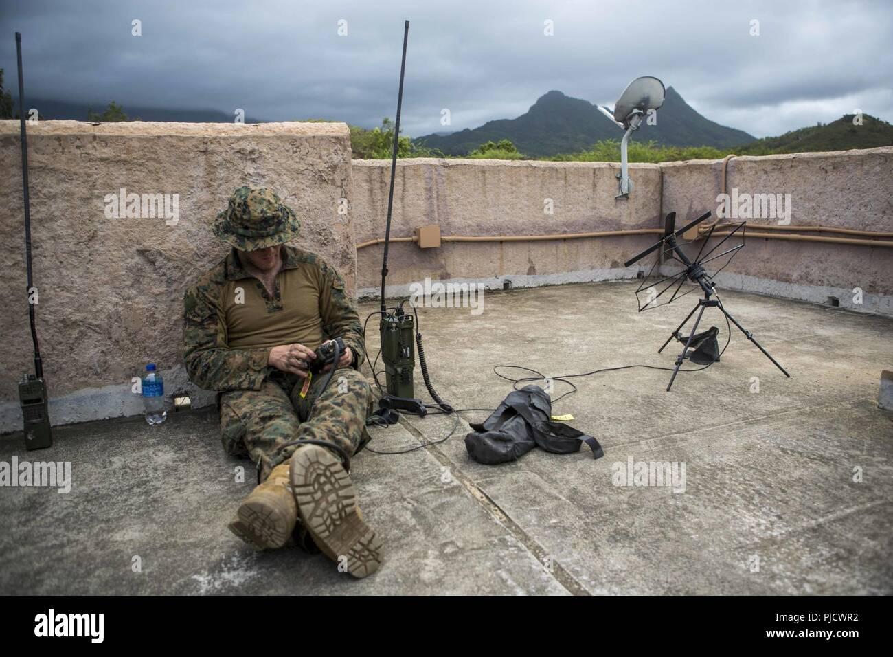 OAHU - A U S  Marine radio operator with Lima Company