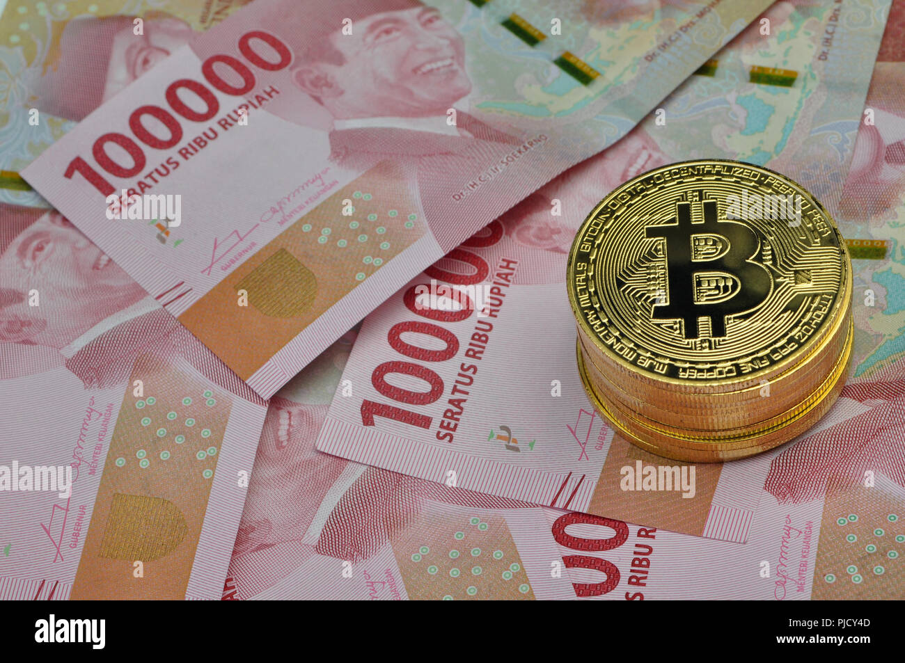 Initial Coin Offering Stock Photos Voucher Deposit Kh Rp 100000 Bitcoin And Indonesia Rupiah Image