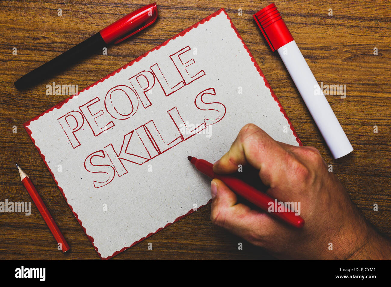 Word writing text People Skills. Business concept for Get Along well Effective Communication Rapport Approachable Man hand holding marker notebook pap - Stock Image