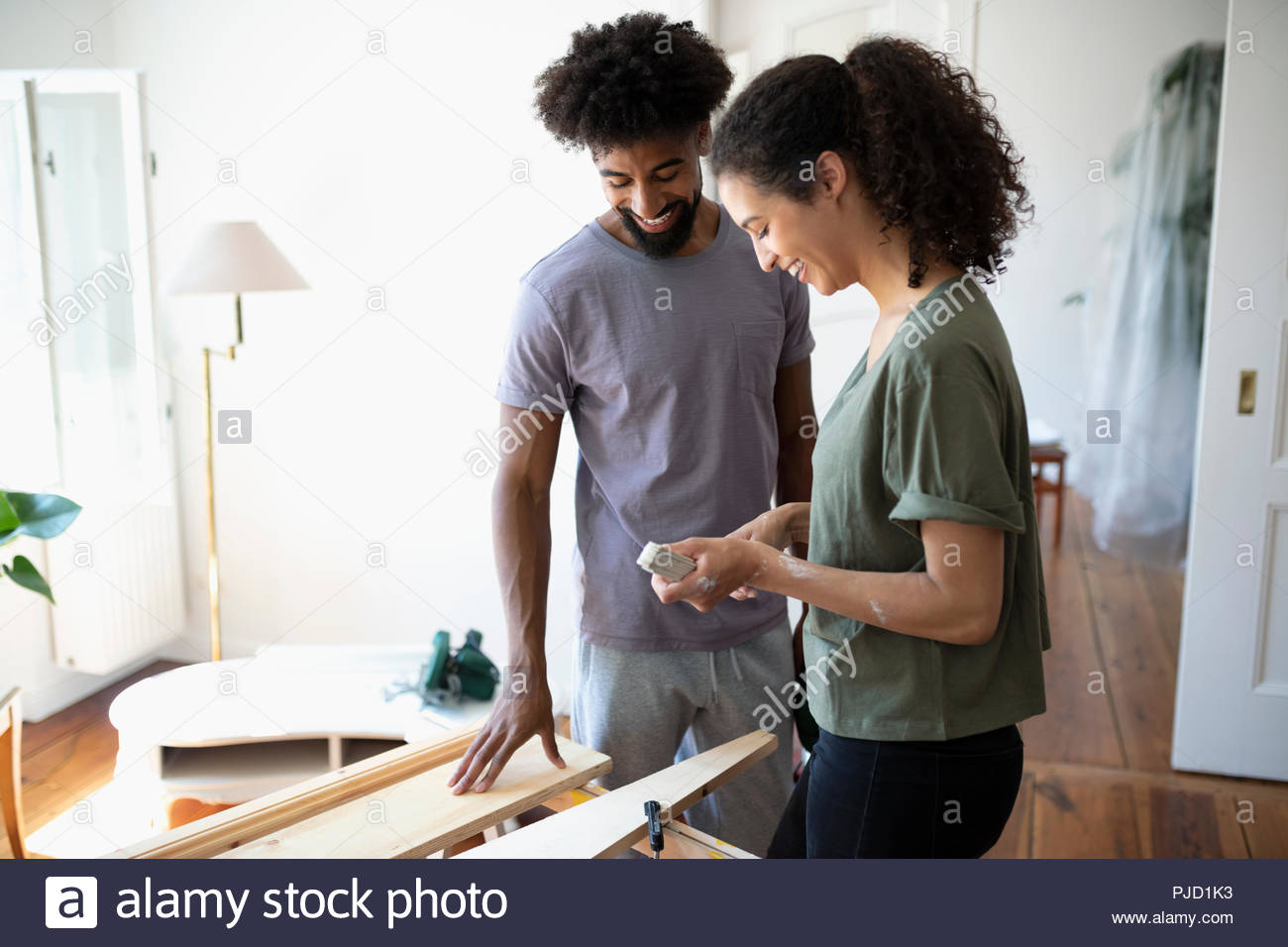 Couple doing DIY carpentry project - Stock Image