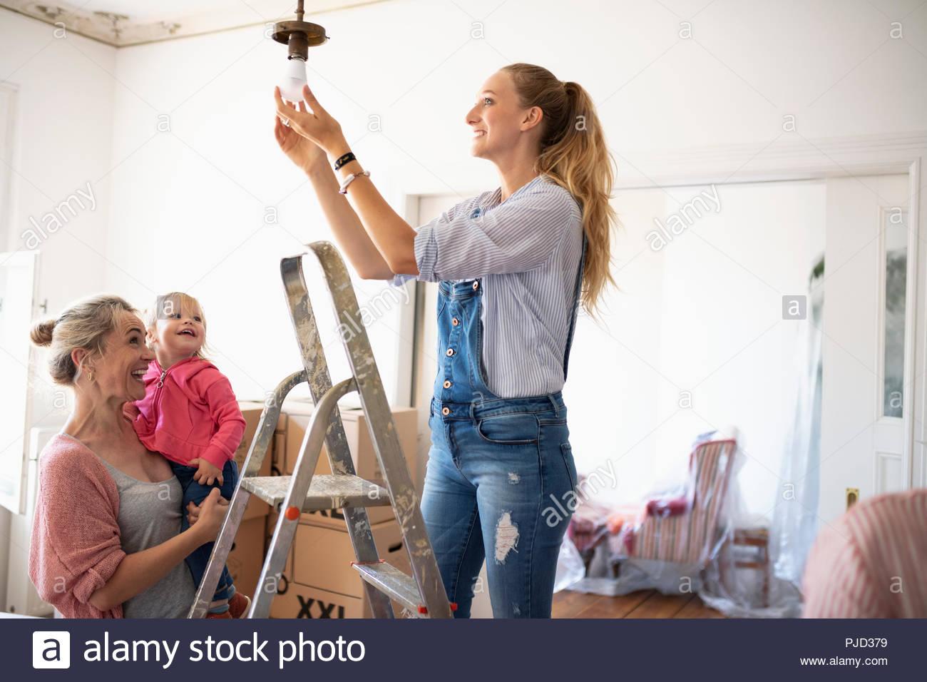 DIY multi-generation family changing light fixture - Stock Image