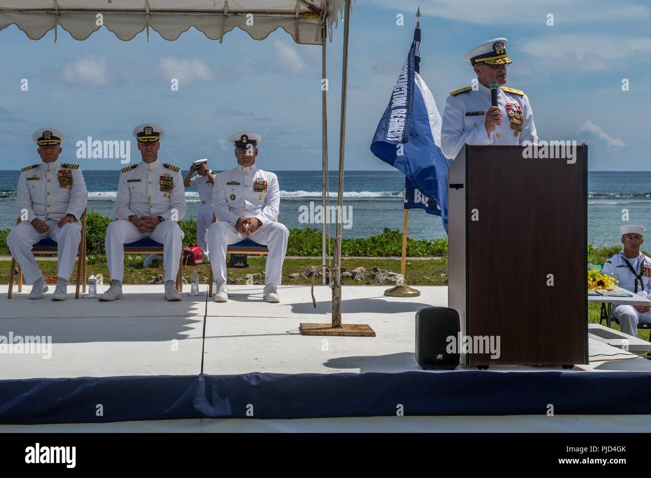 ASAN BEACH, Guam (July 19, 2018) Rear Adm. Troy McClelland, Deputy Commander for the Naval Construction Force, Navy Expeditionary Command, speaks during 30th Naval Construction Regiment's (30 NCR) change of command ceremony at the War in the Pacific National Historical Park Asan Beach Unit. During the ceremony, Capt. Steven Stasick relieved Capt. Jeffrey Kilian as commodore of 30 NCR. Stock Photo