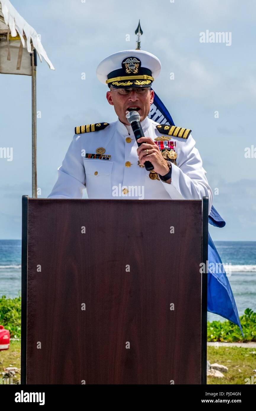 ASAN BEACH, Guam (July 19, 2018) Capt. Jeffrey Kilian, commodore of 30th Naval Construction Regiment (30 NCR), speaks during 30 NCR's change of command ceremony at the War in the Pacific National Historical Park Asan Beach Unit. During the ceremony, Capt. Steven Stasick relieved Kilian as commodore of 30 NCR. - Stock Image
