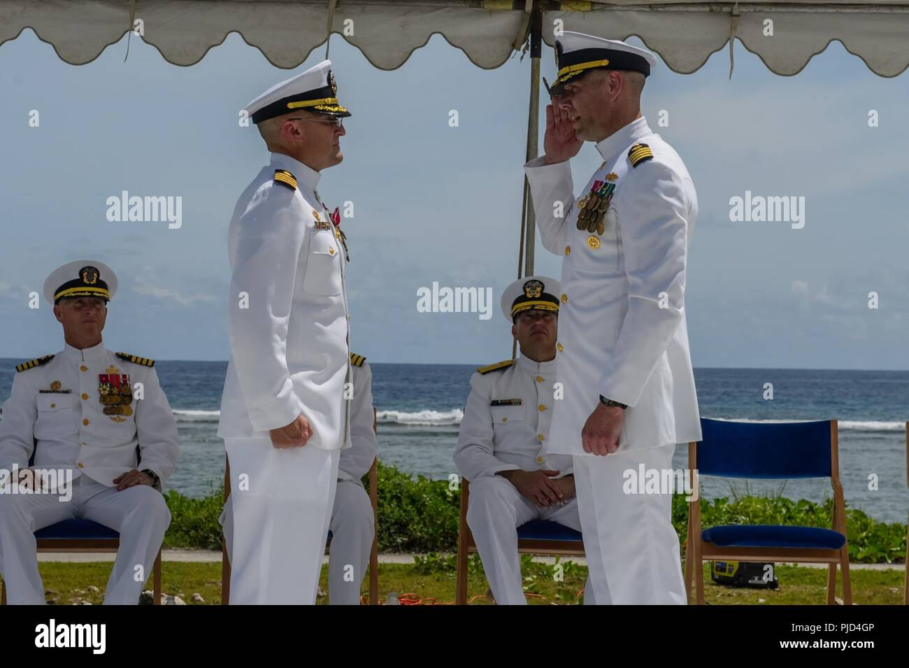 ASAN BEACH, Guam (July 19, 2018) Capt. Steven Stasick (left) relieves Capt. Jeffrey Kilian as commodore of the 30th Naval Construction Regiment during a change of command ceremony at the War in the Pacific National Historical Park Asan Beach Unit. - Stock Image