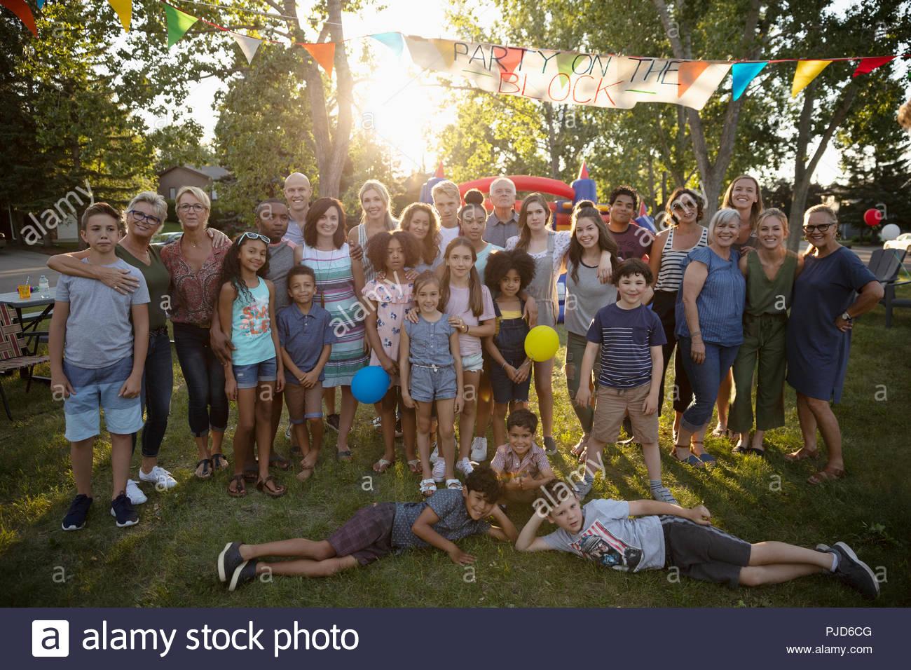Portrait happy neighbors at summer neighborhood block party in park - Stock Image