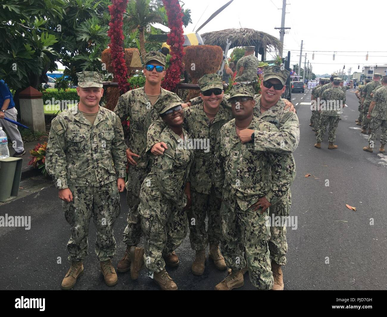 SANTA RITA, Guam (July 21st, 2018) Seabees, assigned to Naval Mobile Construction Battalion Eleven (NMCB) 11, Detachment Guam, pose for a photo during the Liberation Day Parade. NMCB-11 is forward deployed to execute construction, humanitarian and foreign assistance, and theater security cooperation in the 7th Fleet area of operations. - Stock Image