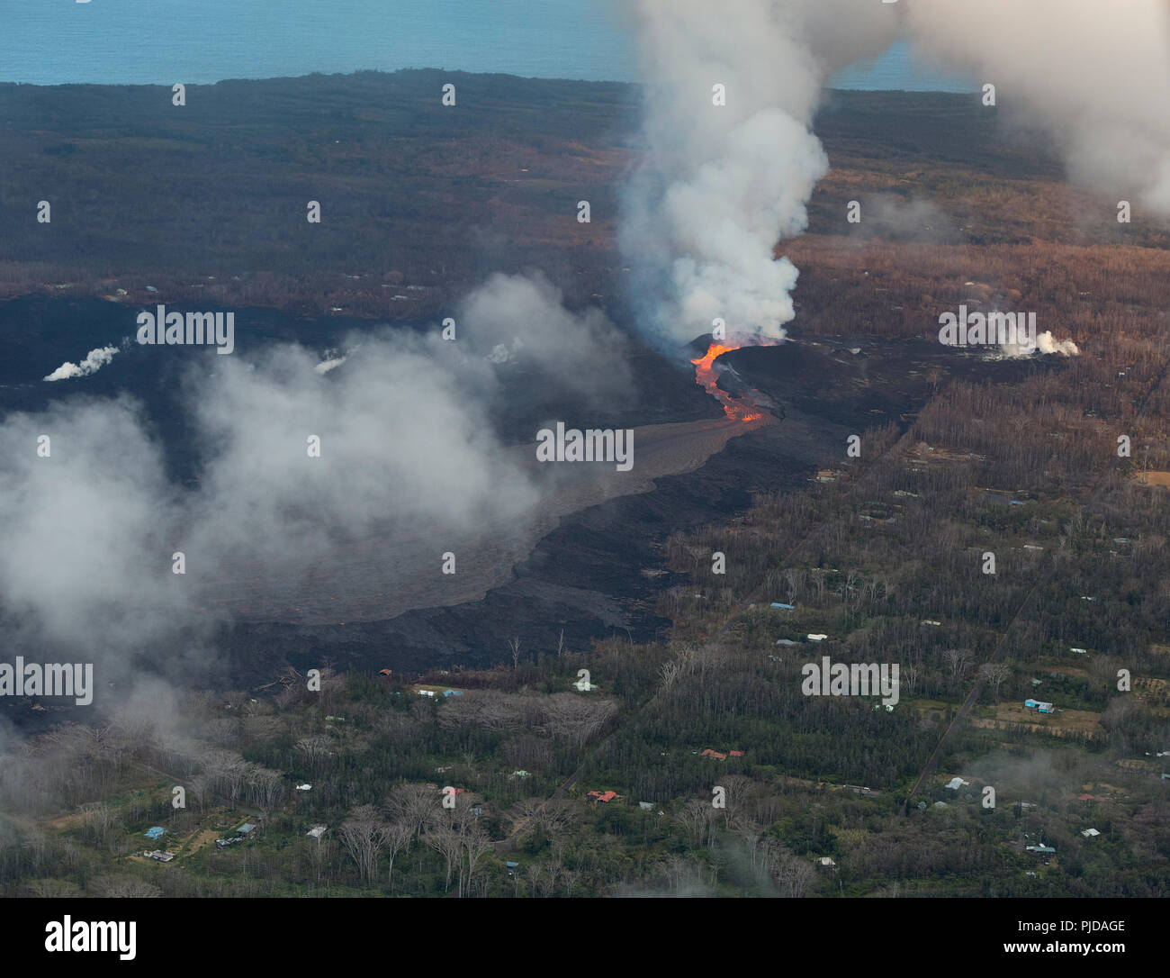 Aerial view of Kilauea Volcano east rift zone erupting hot lava from Fissure 8 in the Leilani Estates residential subdivision near Pahoa, Puna, Hawaii - Stock Image
