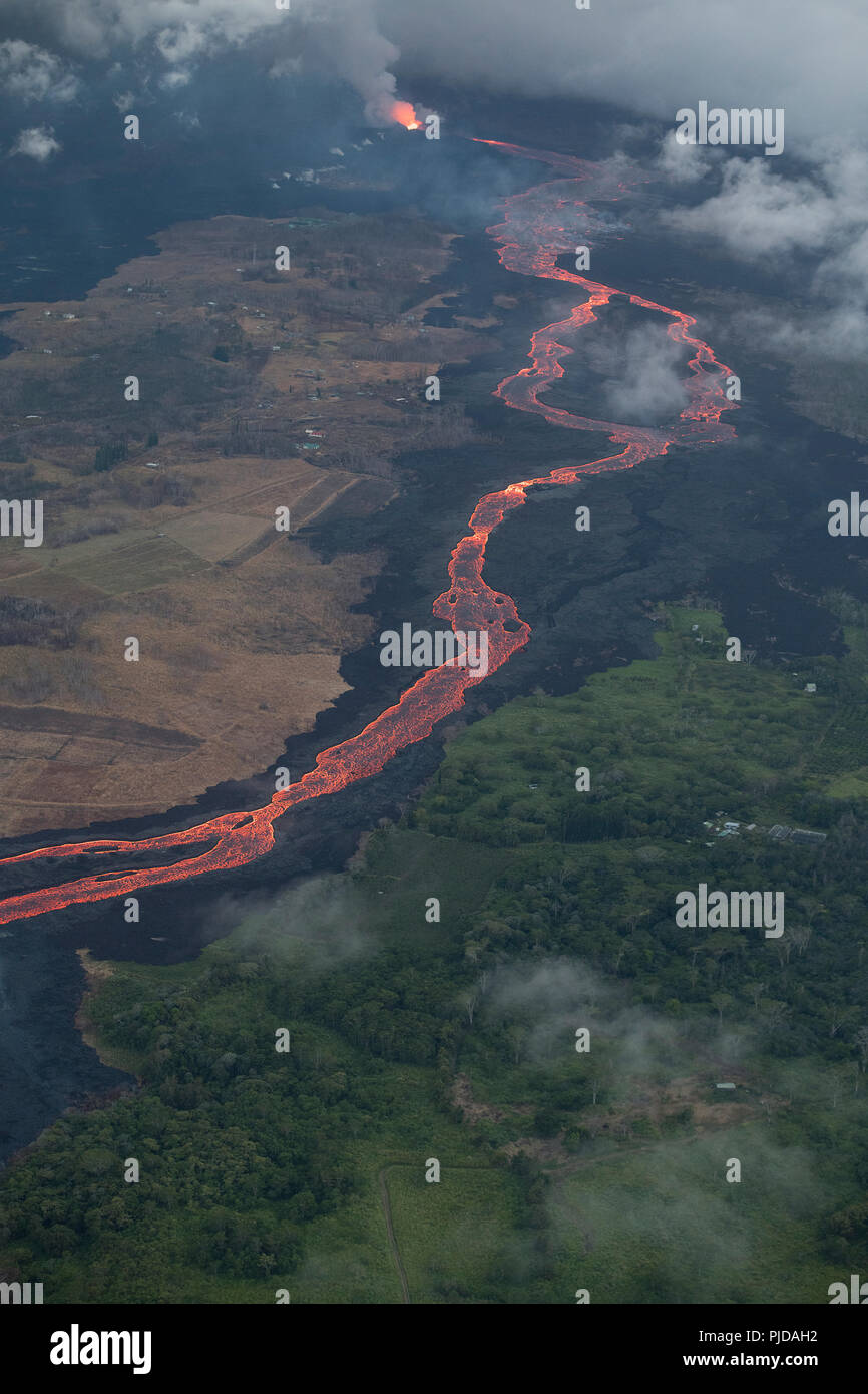 Aerial view of Kilauea Volcano east rift zone erupting hot lava from Fissure 8 in the Leilani Estates residential subdivision near Pahoa, Hawaii - Stock Image