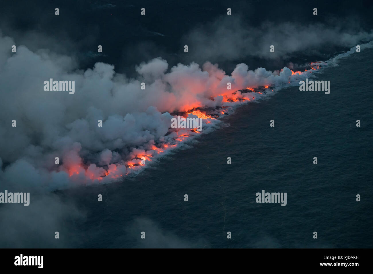 ocean entry Ahalanui, where the lava river erupted from fissure 8 of the Kilauea Volcano east rift zone near Pahoa, Hawaii meets the Pacific Ocean - Stock Image