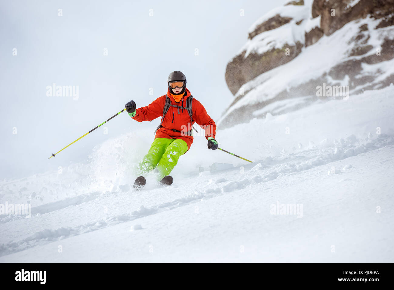 Skier freerides very fast at offpiste slope - Stock Image