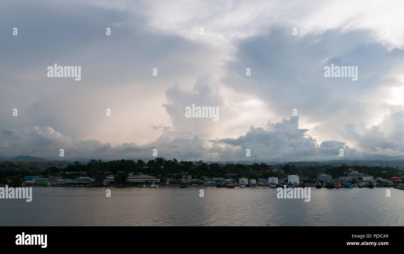 Storm clouds developing over waterfront, Honiara, Guadalcanal, Solomon Islands - Stock Image