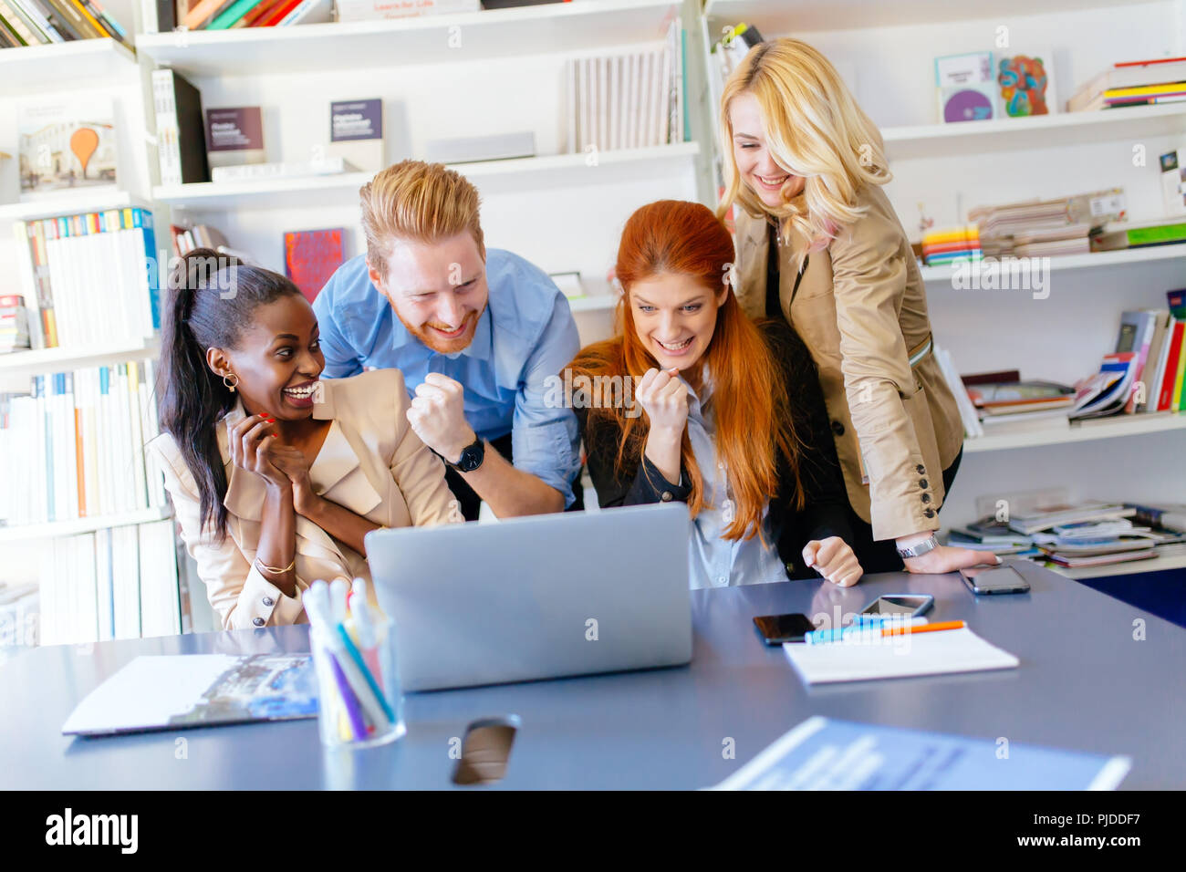 Happy business coworkers celebrating - Stock Image