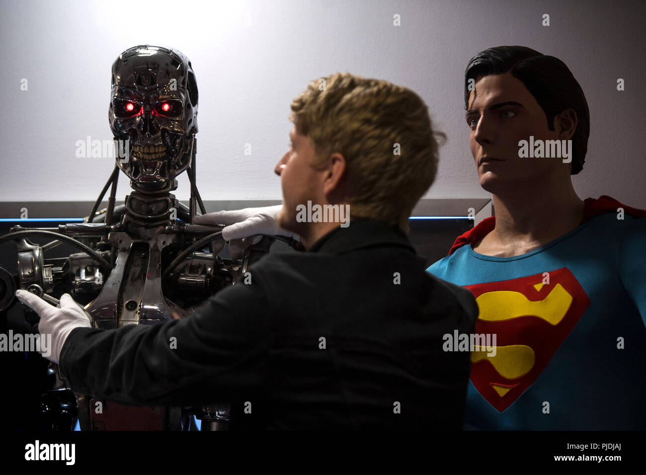 A T-800 Endoskeleton used in Terminator 2: Judgement Day (1991) and a Superman costume used by Christopher Reeve in Superman (1978) and Superman II (1980) at the Prop Store film memorabilia exhibition at the BFI IMAX at Waterloo in central London. - Stock Image