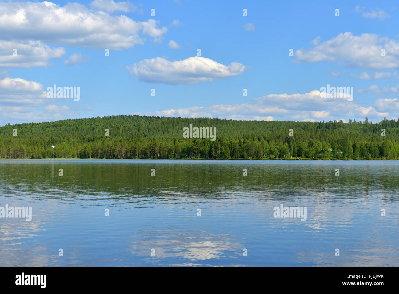 Summer landscape. Picturesque big lake with reflection of clouds in Finnish Lapland - Stock Image