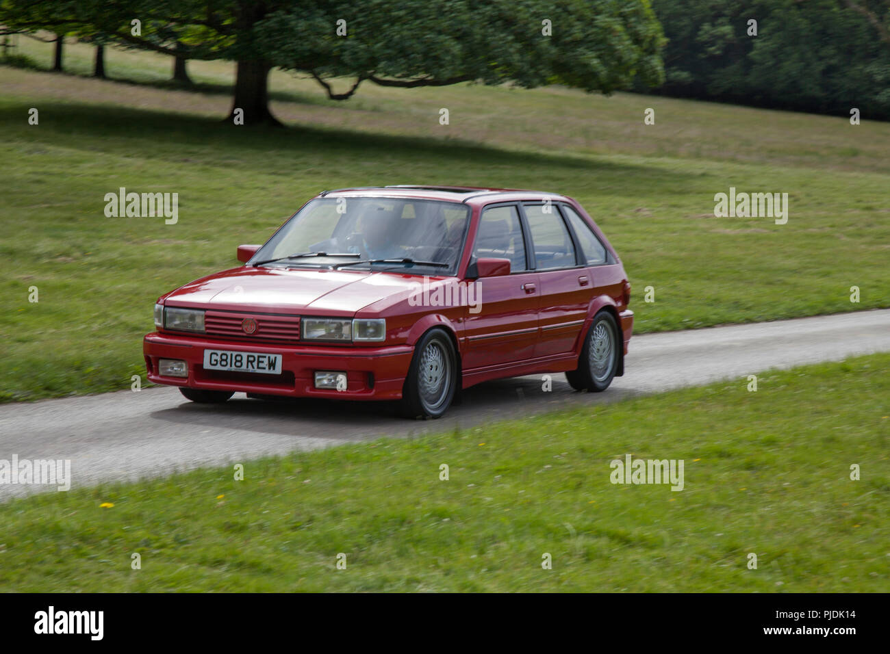 Red 1990 Rover Maestro MG TurboVintage, classic, veteran cars at Carnforth, UK - Stock Image
