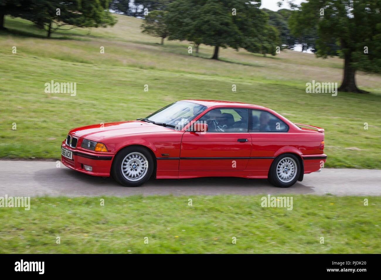 Red 1993 BMW 318 I S Vintage, classic, veteran cars at Carnforth, UK - Stock Image