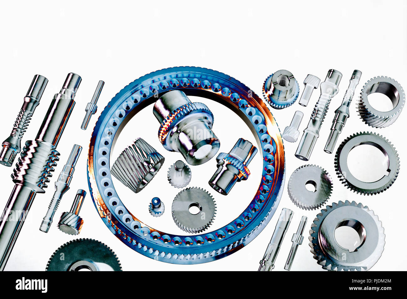 Solarised still life of precision engineered cogs and gears - Stock Image