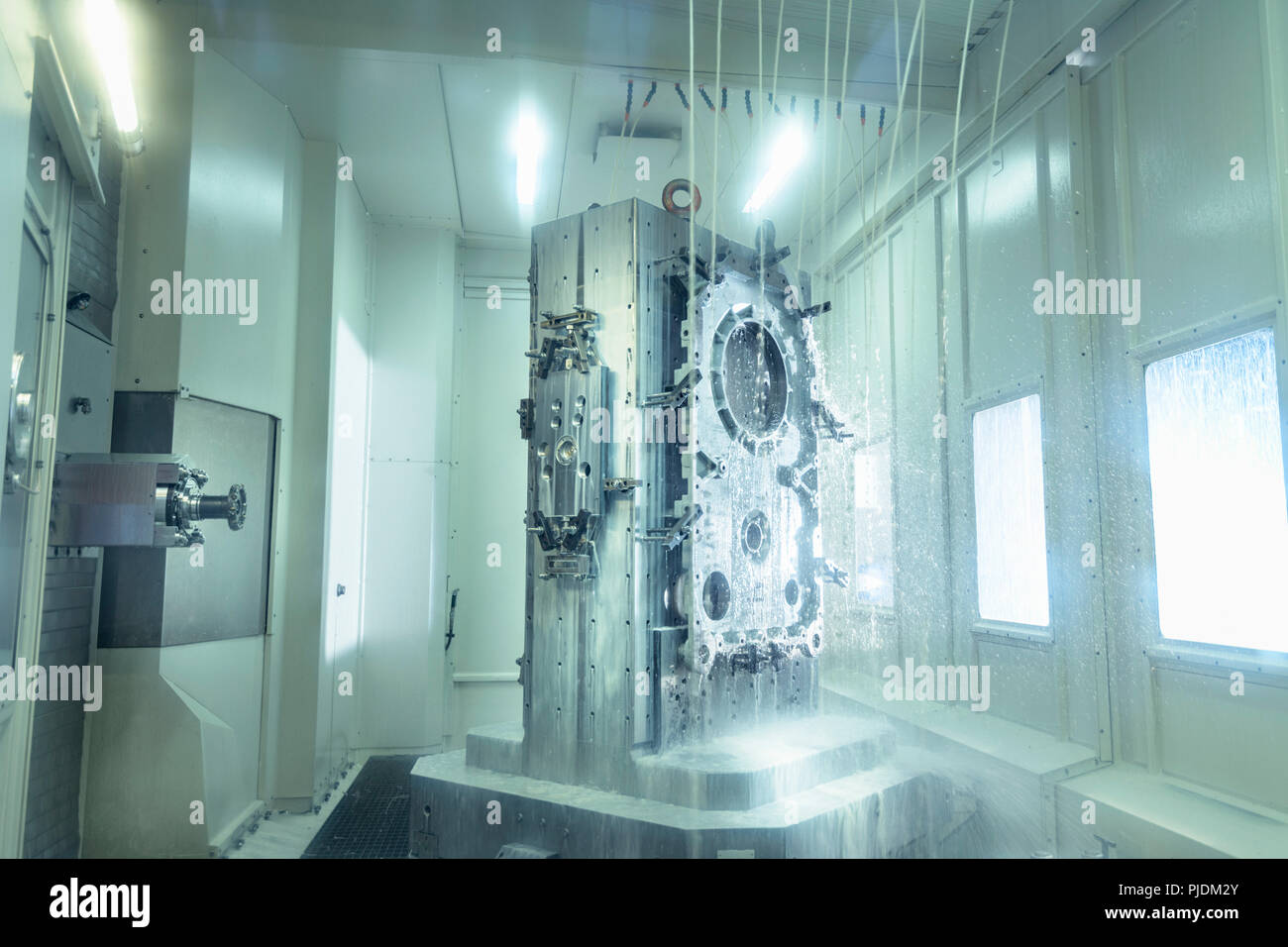 View of parts inside CNC machine in gearbox factory - Stock Image