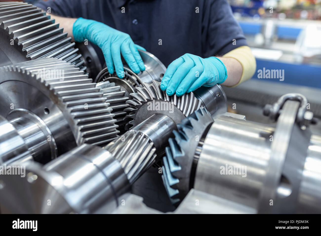 Engineer assembling gearbox in gearbox factory - Stock Image