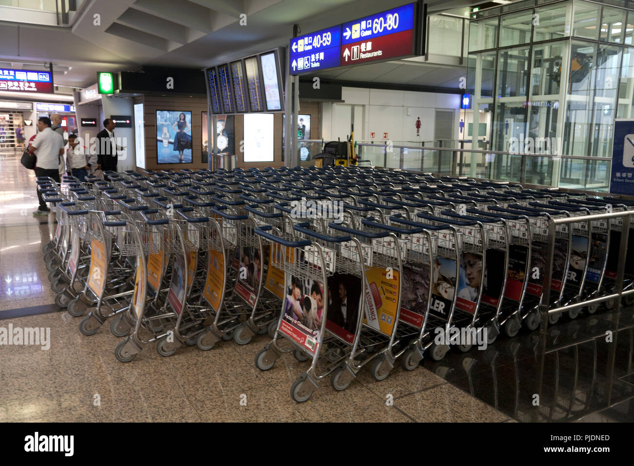 luggage trolleys terminal 1 hong kong international airport chek lap kok hong kong china - Stock Image