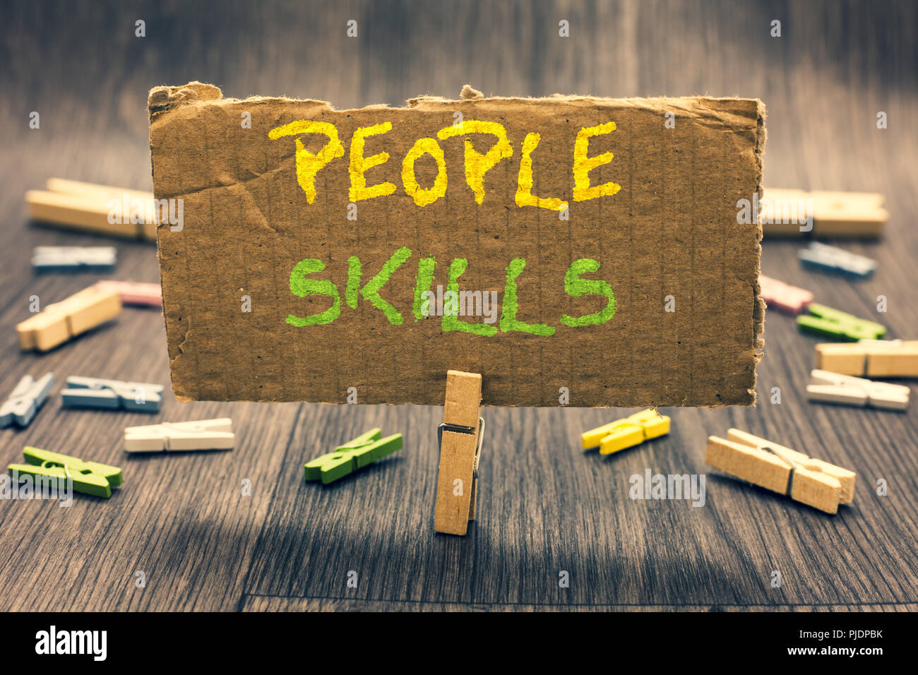 Writing note showing People Skills. Business photo showcasing Get Along well Effective Communication Rapport Approachable Clothespin holding paperboar - Stock Image