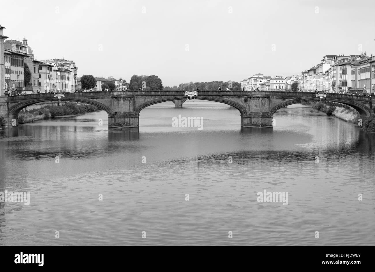 view of the Alle Grazie bridge in Florence over the Arno river - Stock Image