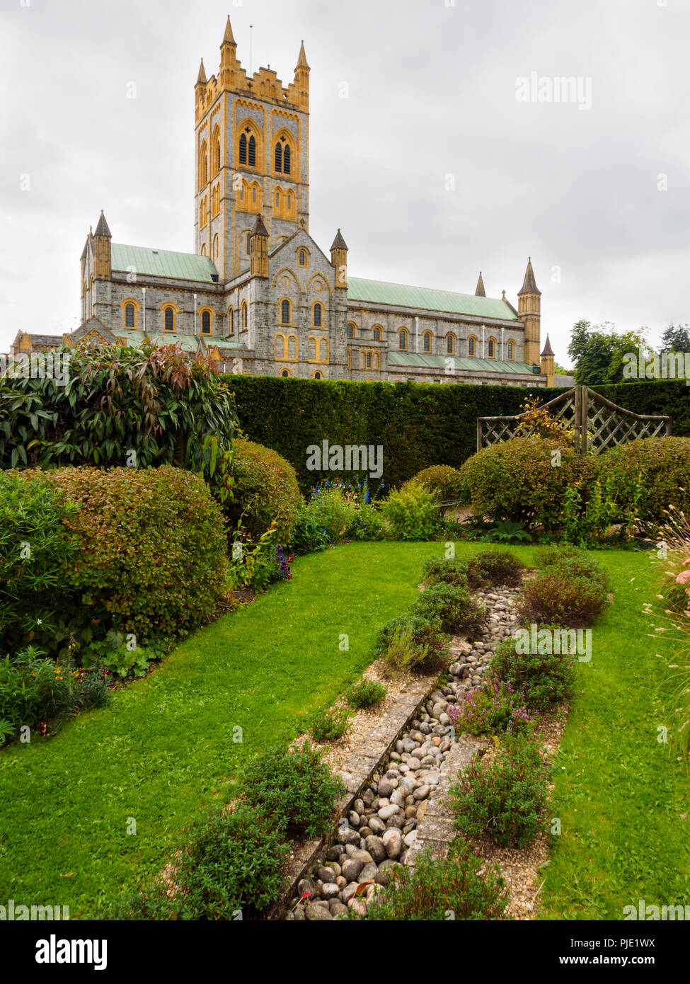 Benedictine Buckfast Abbey Church side view from the Sensory Garden - Stock Image