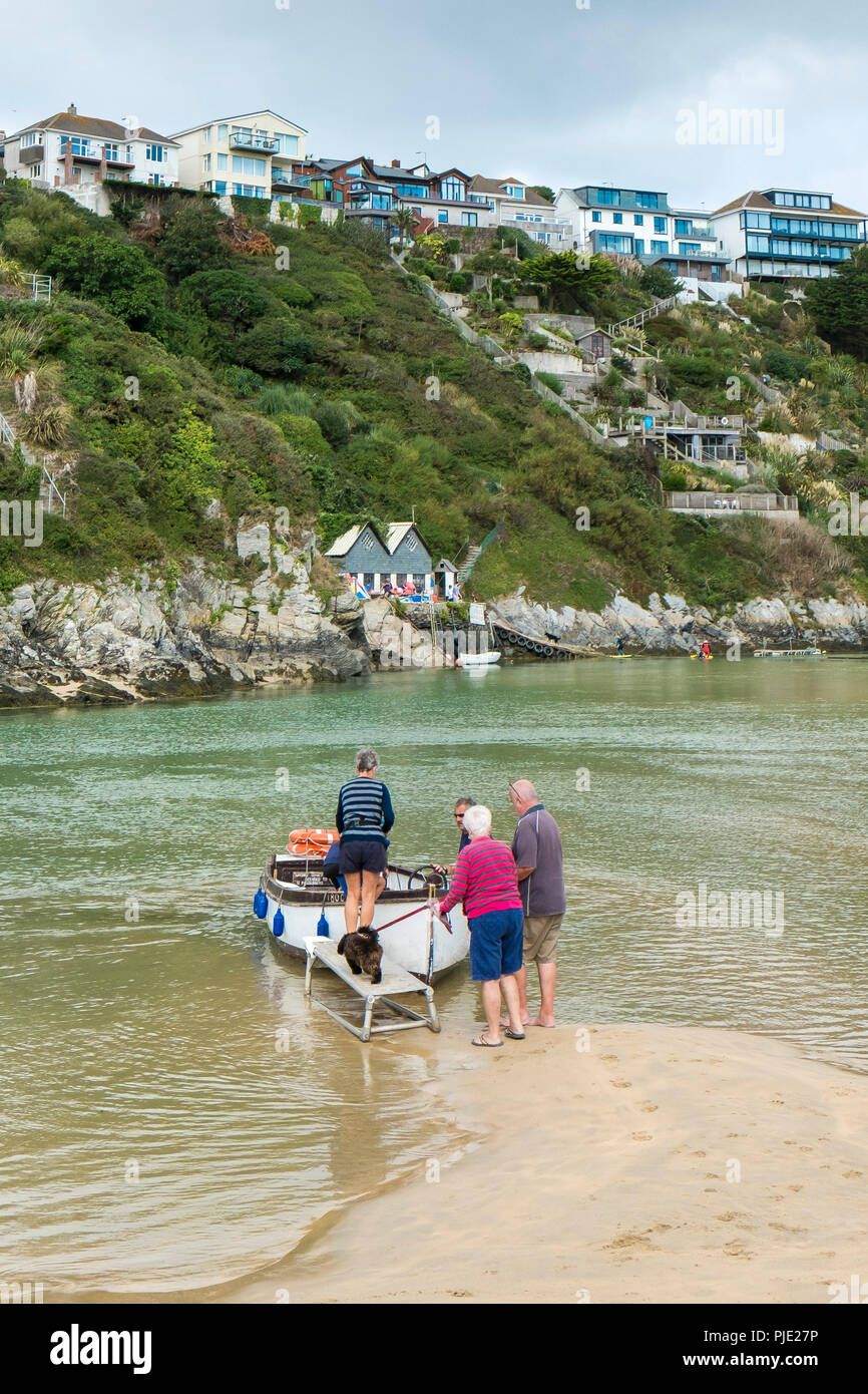 Passengers boarding the River Gannel ferry at Crantock Beach in Newquay Cornwall. - Stock Image