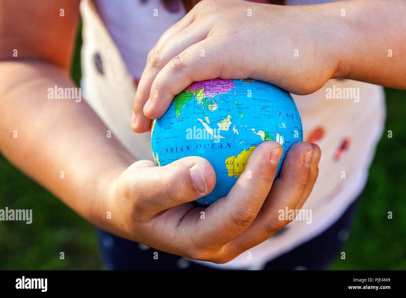 World Map On Hands.Earth Globe In Children Hands Little Girl Holding Symbol World Map