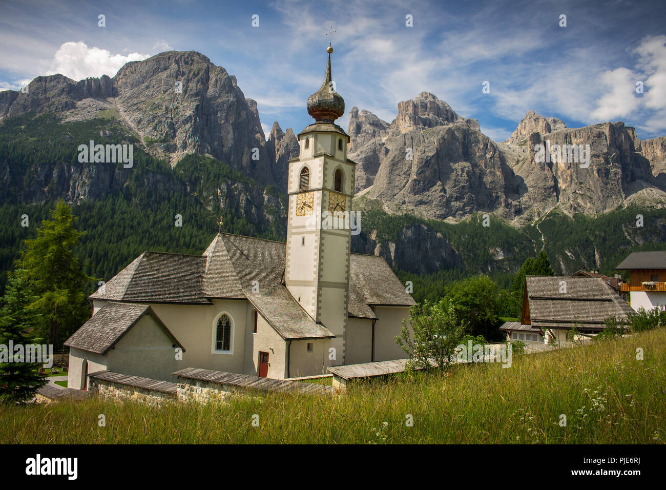 Church of Colfosco in Badia with the Sella Group in the background (Corvara, Val Badia, Bolzano, Alto Adige, Italy) Stock Photo