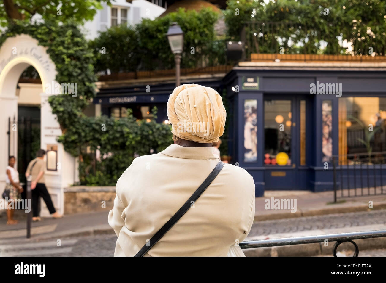 Woman observing a chic restaurant. - Stock Image