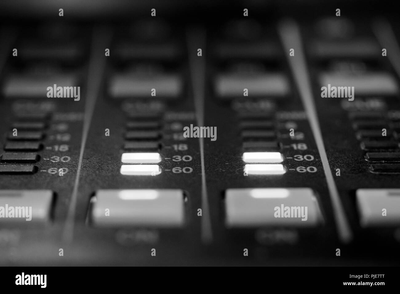 Monochrome LED Meter indicators on Professional Audio Sound Mixing Control Console - Stock Image