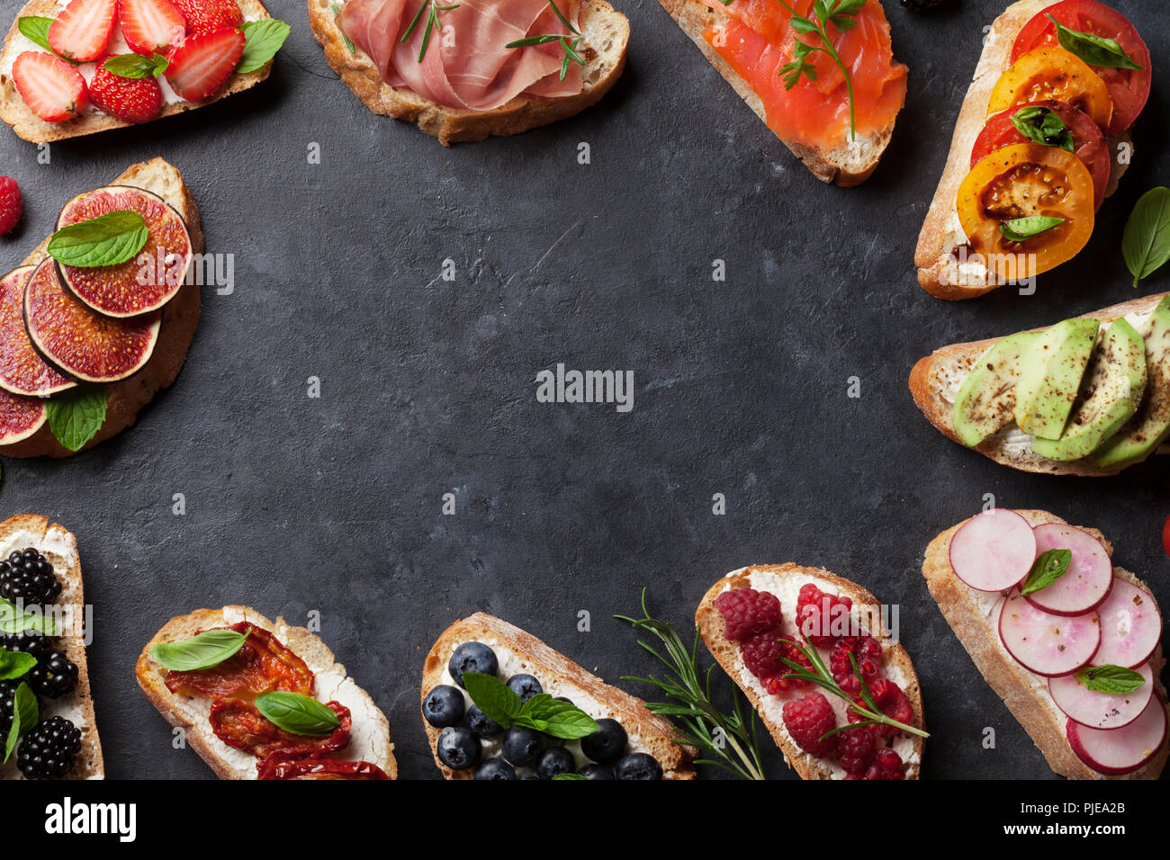 Brushetta or traditional spanish tapas. Appetizers italian antipasti snacks set. Top view and flat lay with space for your text - Stock Image