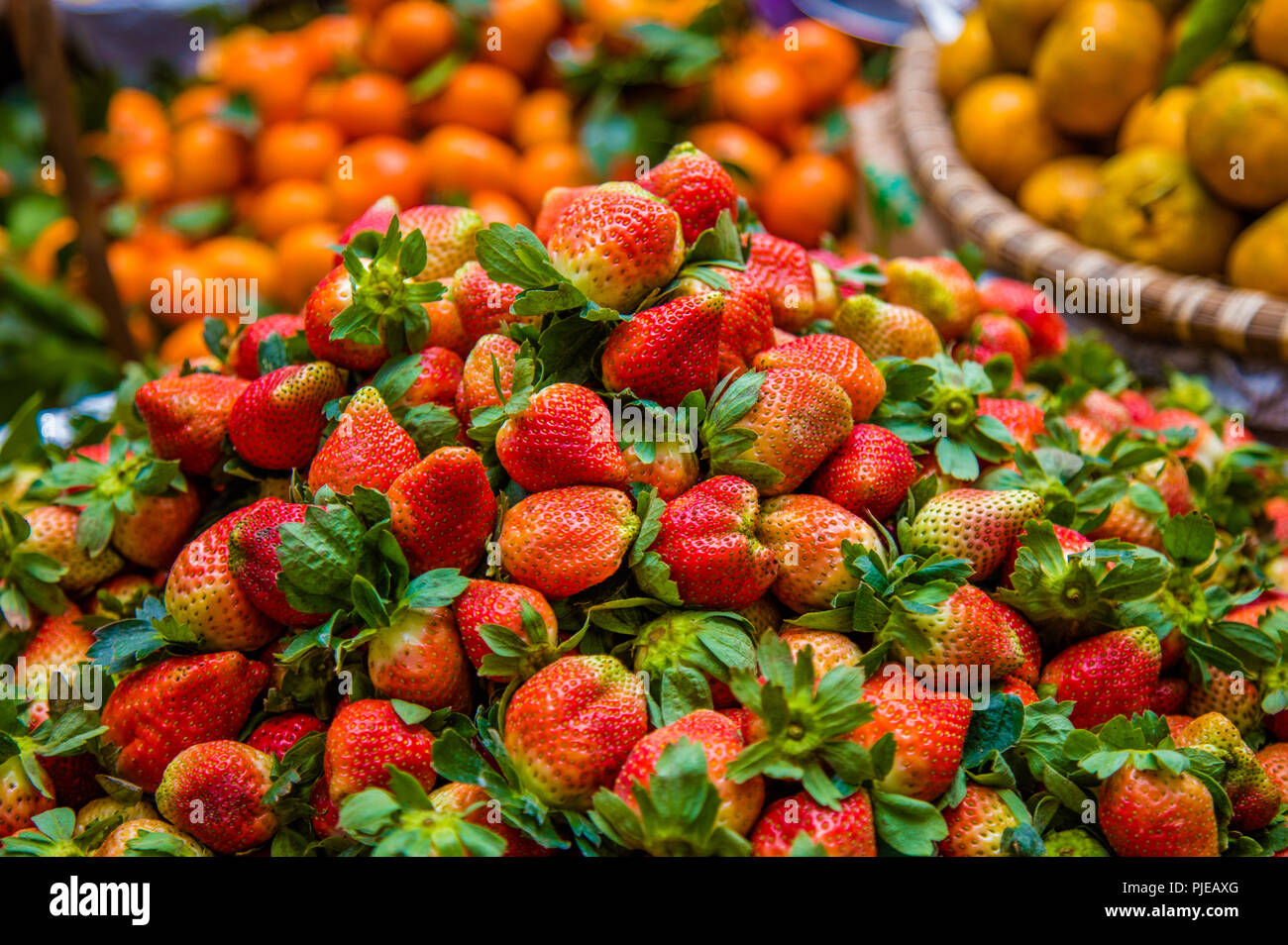 Fresh locally grown strawberries and fruits at the morning ...