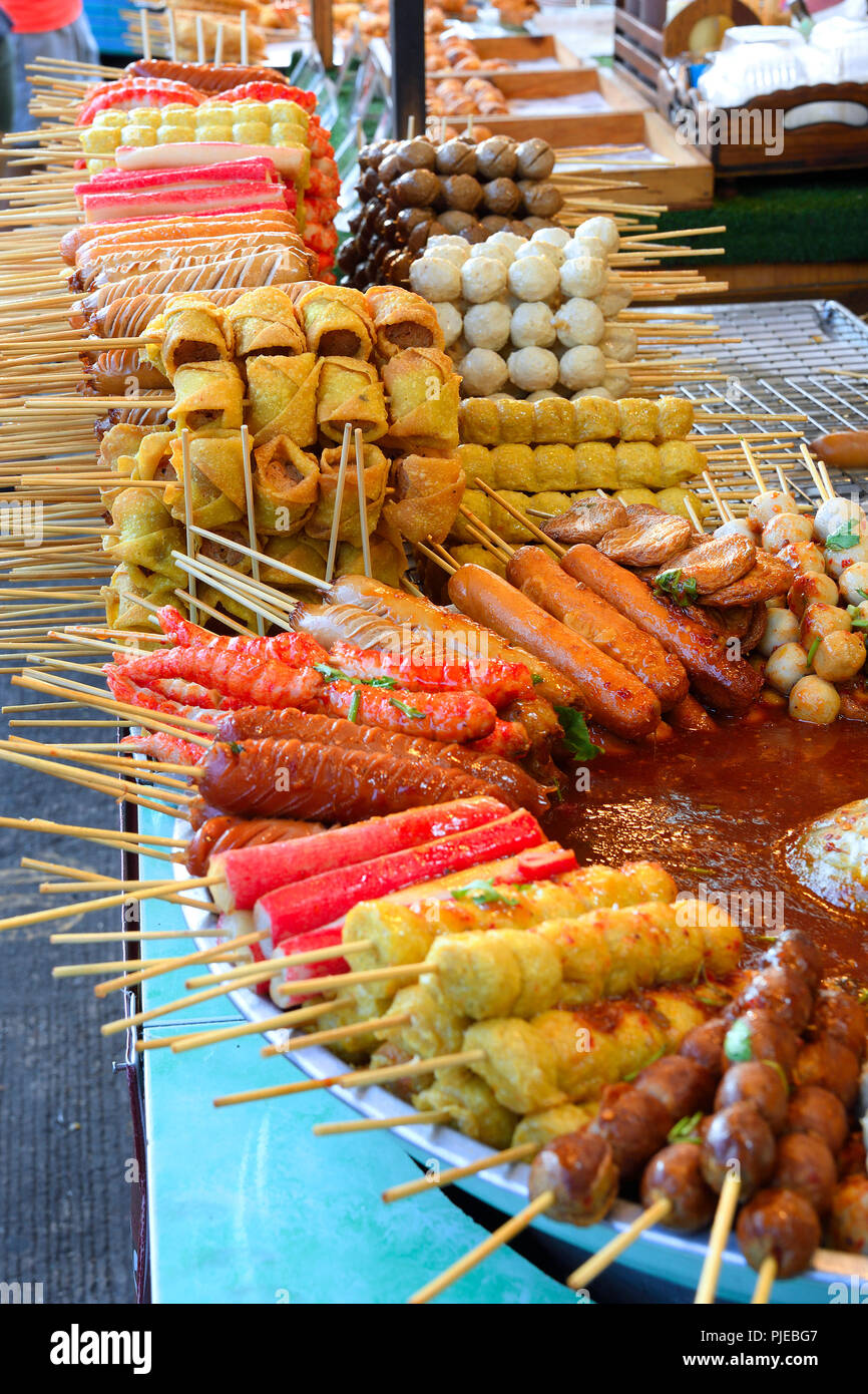 different spits with meat and seafood, Seefood, typically for country, on the Naka weekend Market, Phuket, Thailand, verschiedene Spieße mit Fleisch u - Stock Image