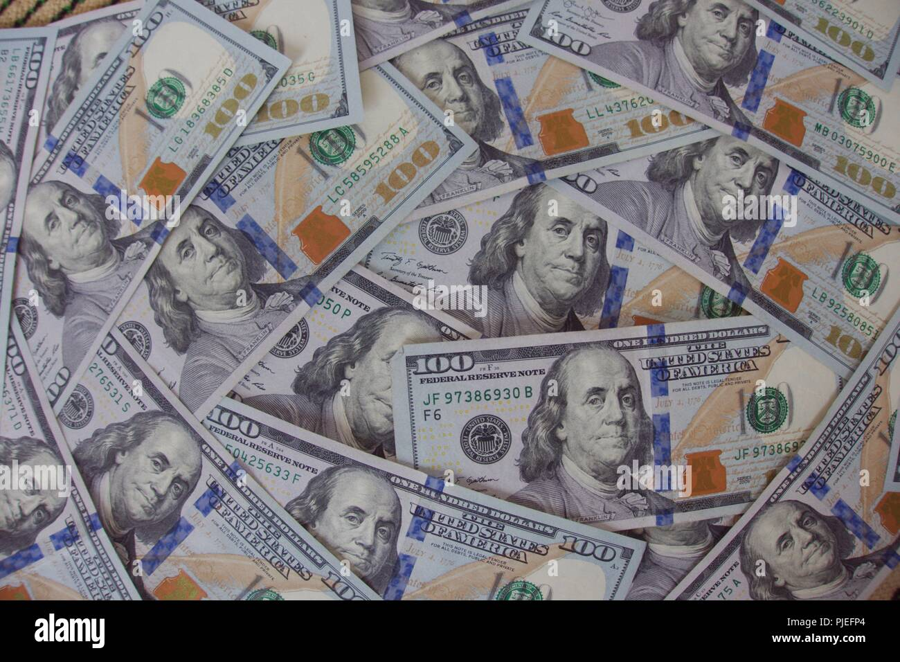 $100 bills US currency with the face of Benjamin Franklin, a very famous American but who was not a president like the faces on other US currency denominations. - Stock Image