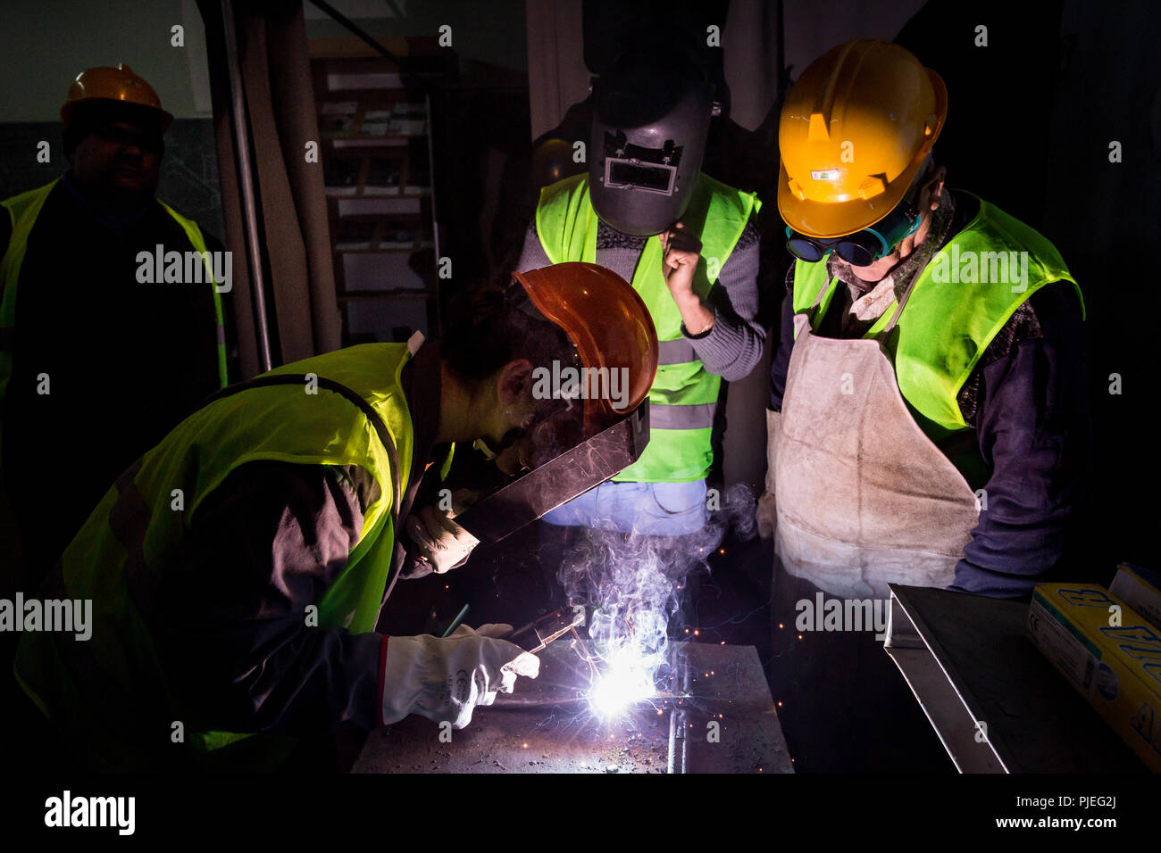 Young Albanians learn welding at the Devaid Training Center Public Professional Training in Tirana, where they learn to weld oxy-fuel. - Stock Image