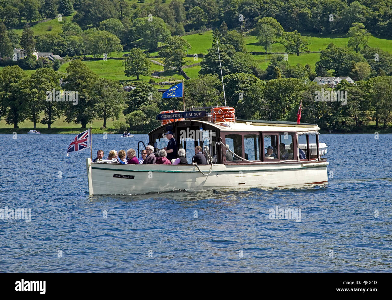 Ferry 'Ruskin', powered by solar energy, on Coniston Water - Stock Image