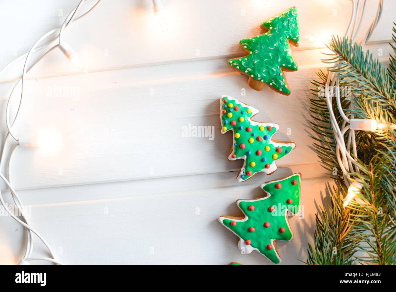 Christmas cookies with festive decoration and christmas lights on ...