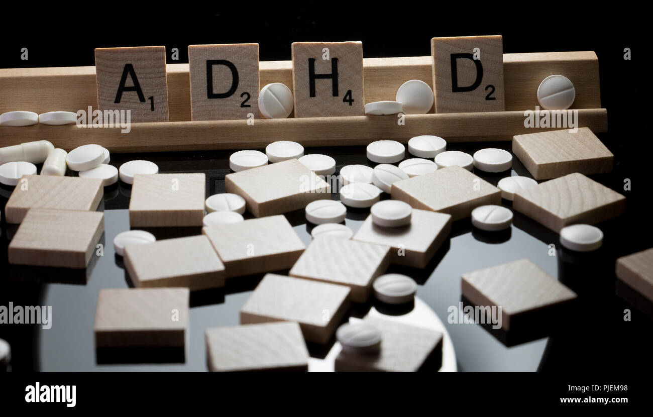 Mental Health Awareness concept for ADHD. Scrabble letters spelling ADHD. - Stock Image