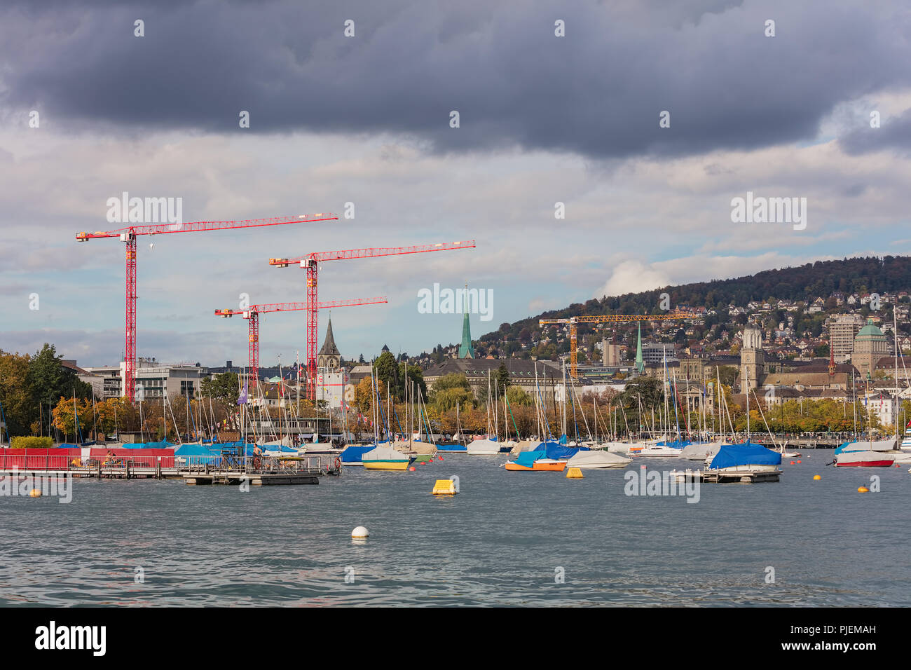 Lake Zurich in the cloudy evening on autumn, the city of Zurich in the background Stock Photo
