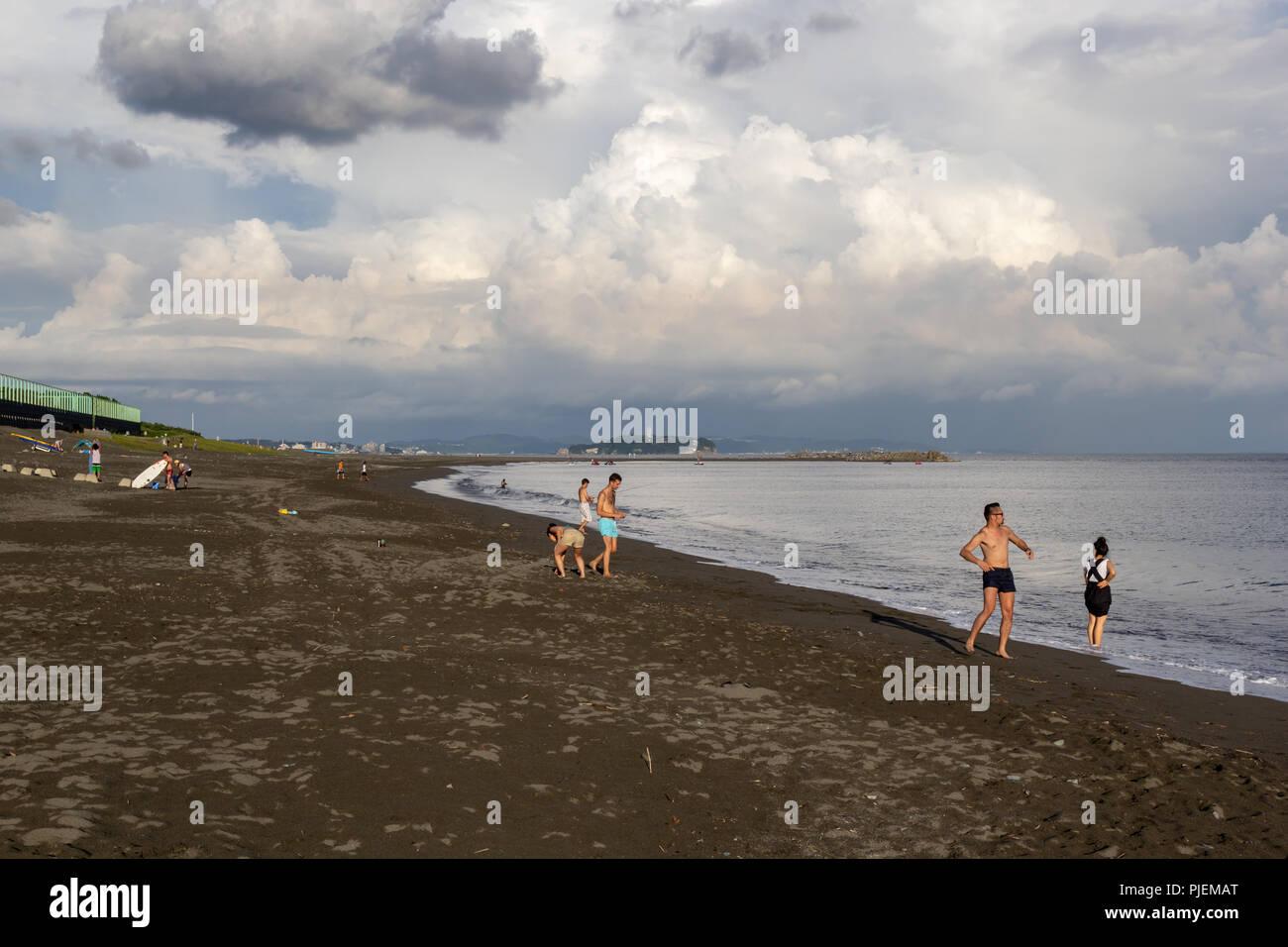 People on the beach; Chigasaki, Kanagawa Prefecture, Japan - Stock Image