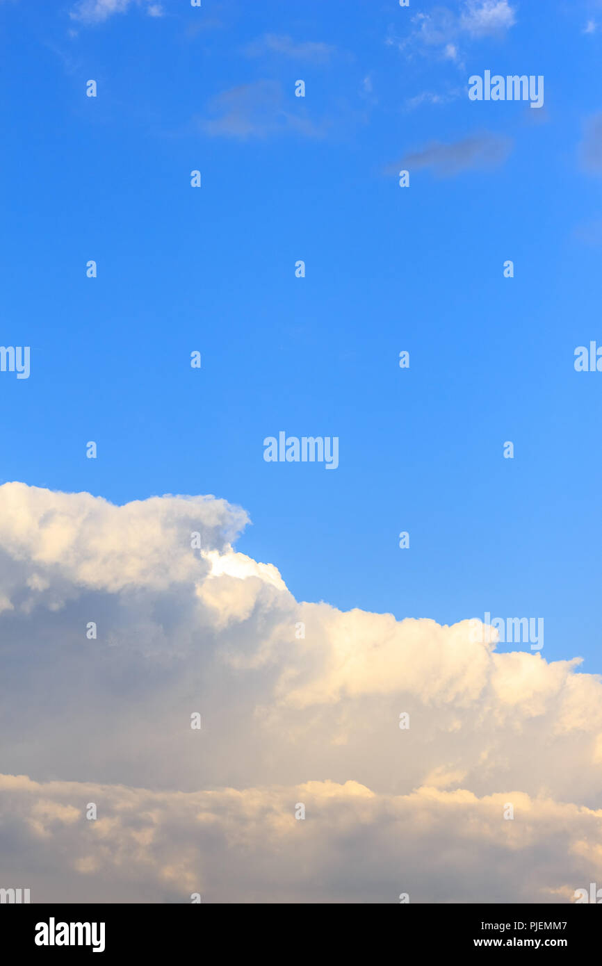 Beautiful sky with cumulus white bright clouds background - Stock Image