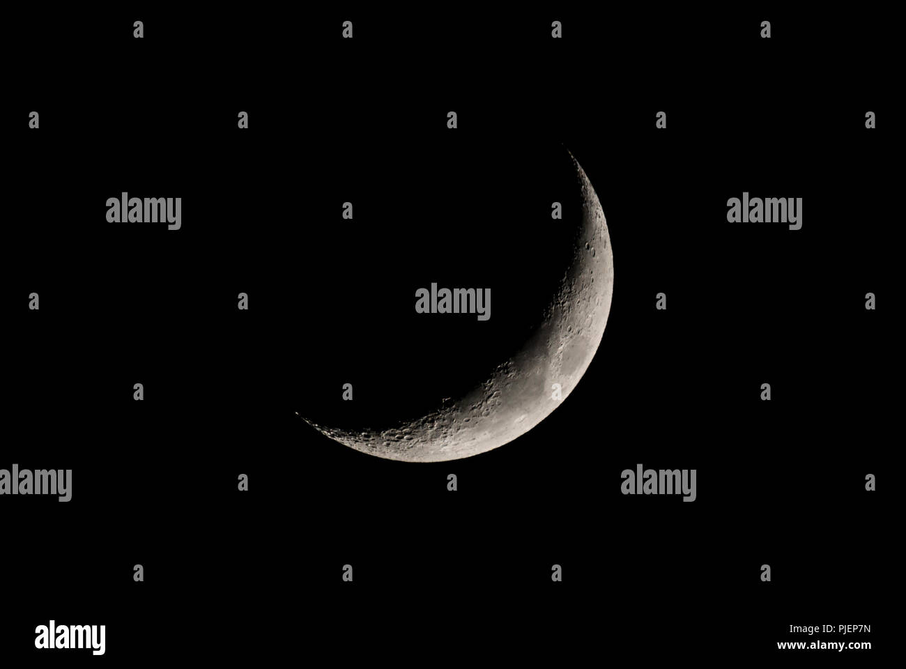 Waxing Crescent moon, 4 days old, in the night sky. New moon. Young moon. - Stock Image