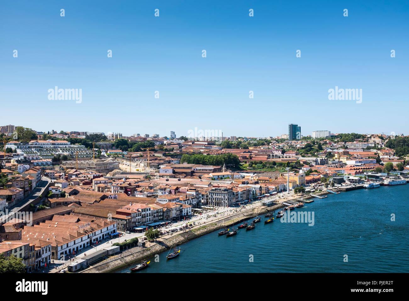View from the Luis 1 bridge, Porto, looking over the port houses of Vila Nova de Gaia. Stock Photo