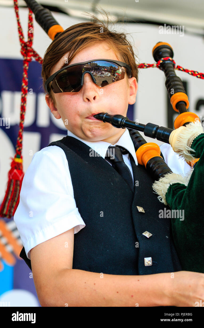 16f600470469 Caucasian child, boy, 11 years old, Ferdinand. Performing on the bagpipes at