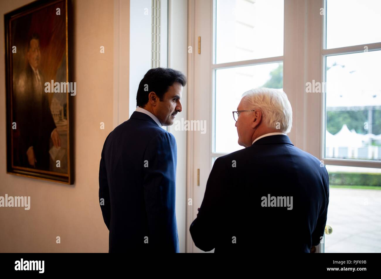 Berlin, Germany. 07th Sep, 2018. 07.09.2018, Berlin: Federal President Frank-Walter Steinmeier (r) stands with the Emir of Qatar, Sheikh Tamim bin Hamad Al-Thani, at a window of Bellevue Palace. Credit: Kay Nietfeld/dpa/Alamy Live News - Stock Image
