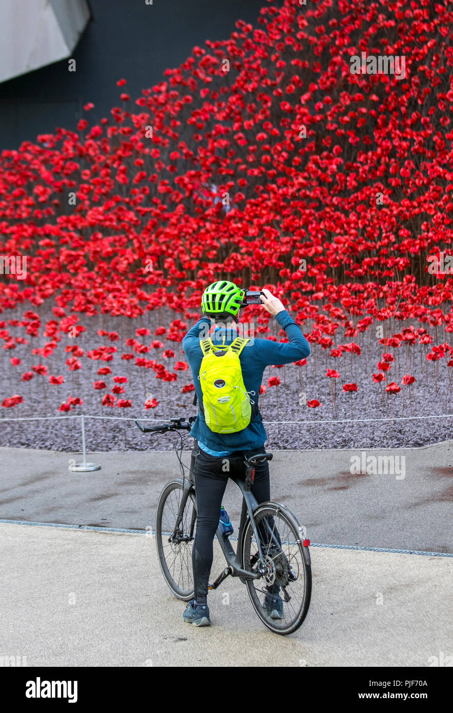 Manchester, UK.7th Sept 2018. The iconic poppy sculpture Wave by artist Paul Cummins and designer Tom Piper at IWM North. This is the final presentation of Wave as part of 14-18 commemoration. It is the first time that Manchester has hosted one of these artworks. The installation 'Blood Swept Lands and Seas of Red' poppies an original concept by artist Paul Cummins and installation designed by Tom Piper. The installation was originally at HM Tower of London where 888,246 poppies were displayed. Credit: MediaWorldImages/Alamy Live News Stock Photo