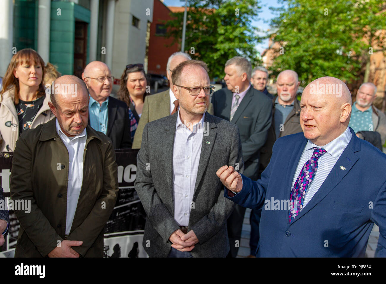 Belfast, UK. 7th September 2018. Barry McCaffrey and Trevor Birney  withy NUJs Seamus Dooley and Gerry Carson, arrive at High Court in Belfast High Court who Fine Point Films brought emergency proceedings to Belfast High Court today, challenging the legality of the search warrant used by police in their search at its Belfast offices last week Credit: Bonzo/Alamy Live News - Stock Image