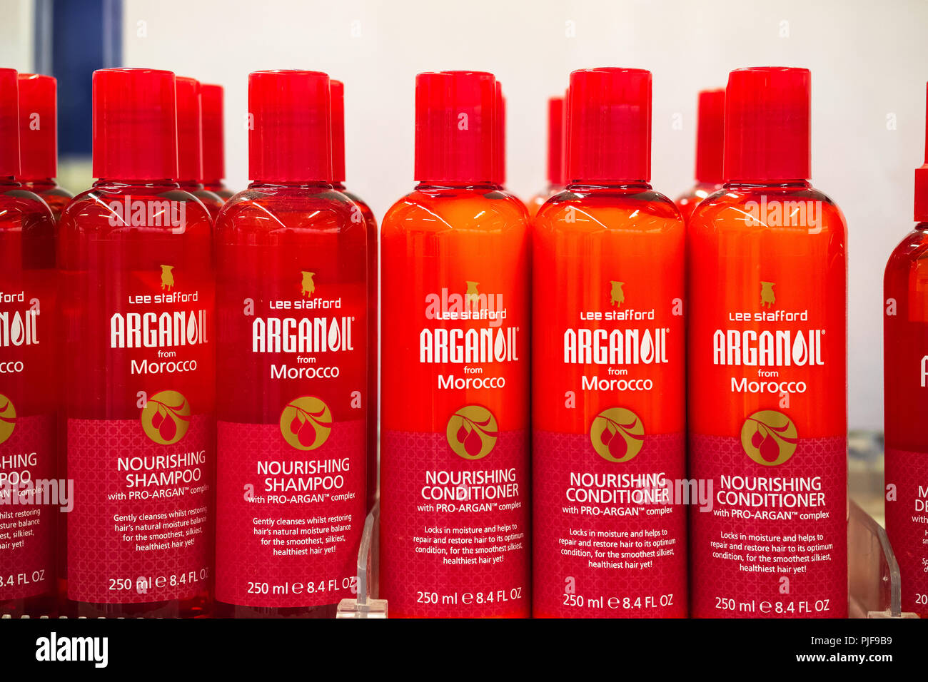 London, UK - August 12, 2018 - Lee Stafford ARGANOIL nourishing shampoo and conditioner on display at Boots duty free shop in London Heathrow Airport - Stock Image